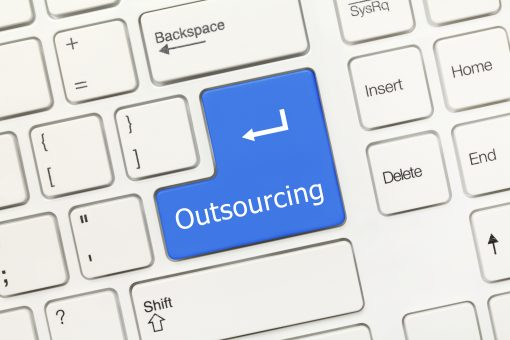 Why is it cheaper to outsource transcription particularly for universities and the NHS?